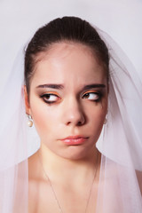 Portrait of a beautiful bride crying, closeup