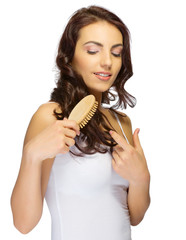 Young healthy girl with hairbrush