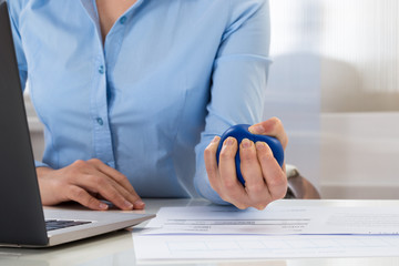 Businesswoman Holding Stress Ball