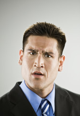 Asian businessman looking confused