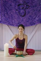 Hispanic woman practicing religious ritual