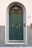 Porta in legno verde, ingresso vecchia casa signorile