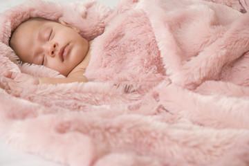 Hispanic baby sleeping in blanket