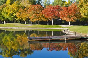 Dock on calm lake in autumn