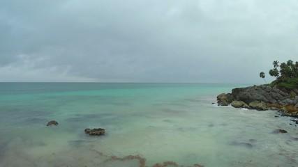 Gray sky over rocky Caribbean beach near Tulum, Mexico