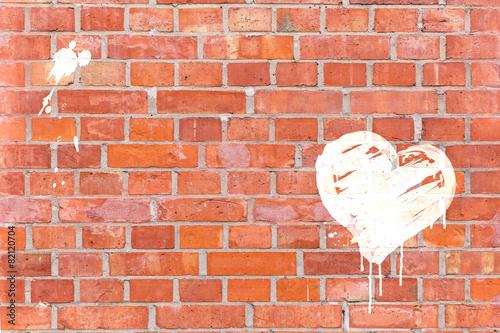 Poster Graffiti-Herz auf eine Mauer gerendert mit Platz für Text