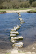 Stepping stones across the River Ogmore in South Wales UK - 82121325