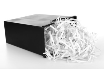 Strips of destroyed paper from shredder in trash can isolated