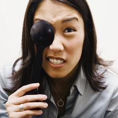 Asian woman covering eye