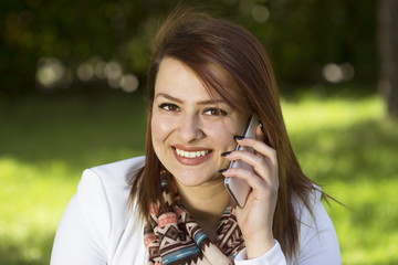 Happy young woman on cell phone