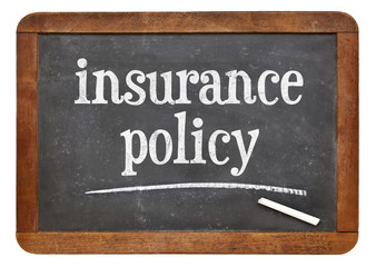 insurance policy text on blackboard