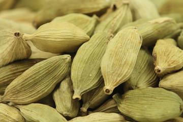 Dried green cardamom seeds closeup