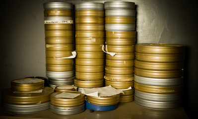 Pile of many 35 mm movie film boxes in warehouse