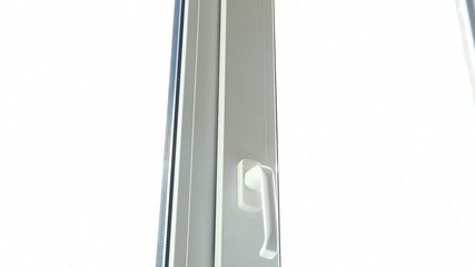 View of closing a vertically open window