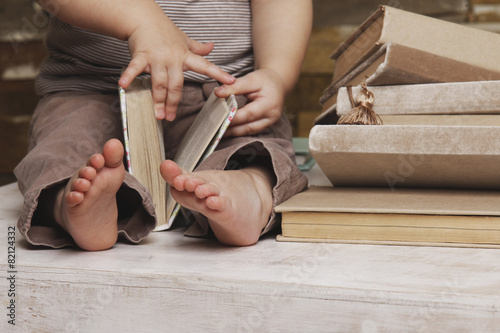 Leinwanddruck Bild Small feet of a child