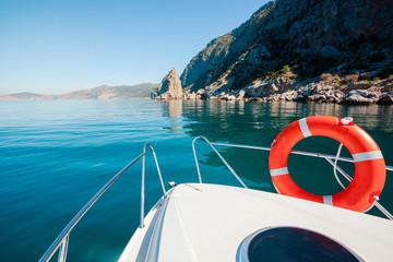 Boat floats near mountains. Luxury Lifestyle. Traveling on yacht