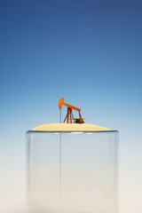 Oil pump on top of empty glass