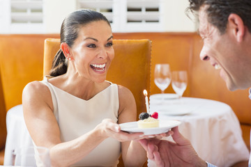 Couple celebrating birthday at restaurant