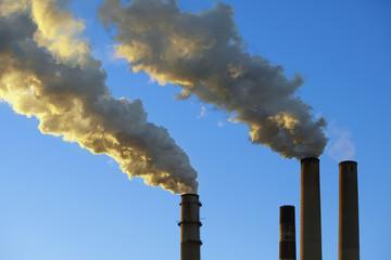 Smoke emitting from factory smoke stacks
