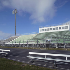 Empty running track and bleachers