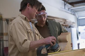 Multi-ethnic men working in wood shop