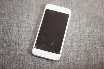 Crashed white smart phone with touchable screen