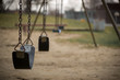 Empty Swings at Playground on Dull Day - 82129123