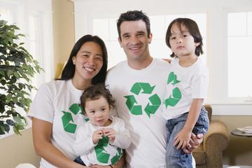 Mixed Race family wearing recycling t-shirts