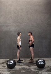 Caucasian weight lifters examining each other