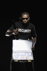 African security guard with briefcase full of money