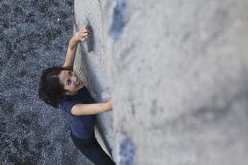 Filipino woman rock climbing