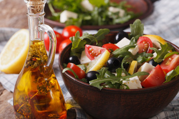 Delicious fresh salad with arugula, feta cheese and tomatoes