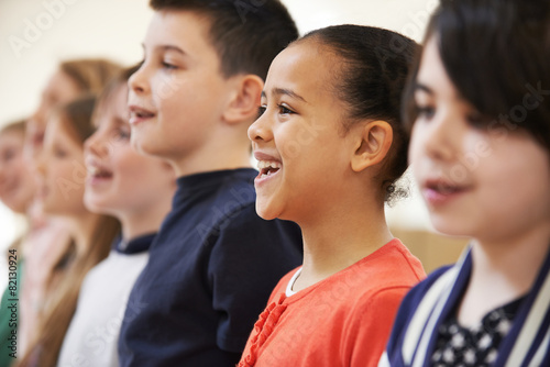 Group Of School Children Singing In Choir Together - 82130924