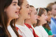 Group Of School Children Singing In Choir Together - 82131359