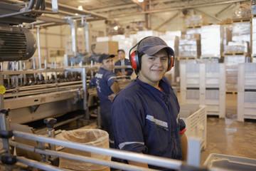 Hispanic man working in bottling factory