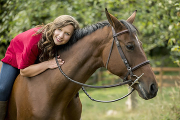 Caucasian woman sitting on horse outdoors