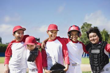 Multi-ethnic boys in baseball uniforms