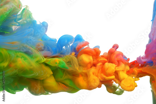 Clouds of bright colorful ink mixing in water - 82134385