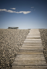 Wooden Walkway and Picnic Table at the Beach
