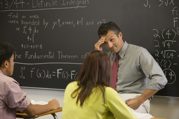Frustrated teacher explaining arithmetic to students