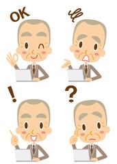 表情 ノートパソコンを使う熟年ビジネスマン