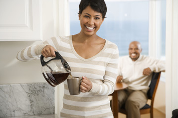 African woman pouring coffee
