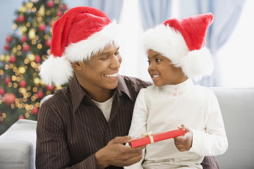 African father and son holding gift