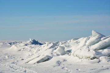 Polar landscape- frozen sea with blue sky background