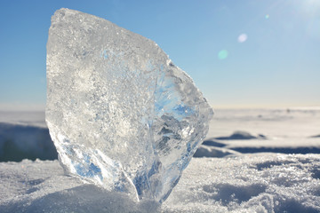 Crystal clear ice at sunny day at frozen sea