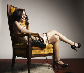 Hispanic woman talking on telephone