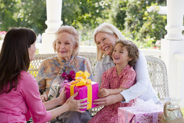 Four generations of Caucasian women at party