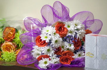 Festive bouquets and greeting card on the table.
