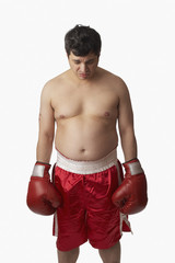 Portrait of overweight boxer