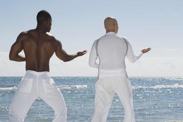Multi-ethnic men practicing yoga